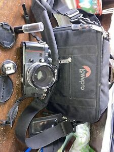 Nikon F3 Camera  With A Lens And Lowepro Camera Bag. Lens Is A Nikkor Nikon