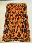 vintage handmade hooked rug orange and black geometric pattern