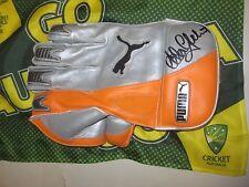 Adam Gilchrist (Australia) signed Puma Wicketkeeping Glove (Orange/Silver) + COA