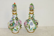 Pair porcelain scent bottles, some chipping of flower-leave petals,matching tops