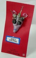 Greg Delaney handcrafted wearable sculpture pin mixed media collage polymer clay
