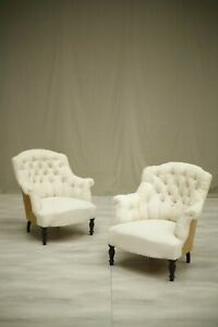 Pair of Napoleon III buttoned shield back armchairs