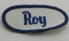 Roy Embroidered Name Oval Sew-On Patch Italicized Blue Letters on White