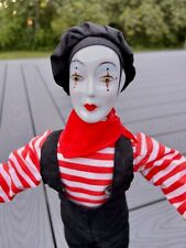 French Mime doll holding theatrical masks of tragedy and comedy