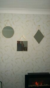 A SET OF 3 WALL MOUNTED WALL MIRRORS HAVING GOLD COLOURED FRAMES AND CHAIN