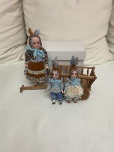 antique set with 3 rabbits and wooden handcart