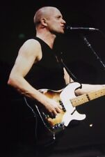Photo of Sting in concert, original 12 x 8 inches by Mel Longhurst