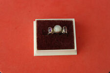 925 Silver Ring With 2 Amethyst And 1 Moonstone Gems  2.4 Gr. 0.5 Cm. Wide