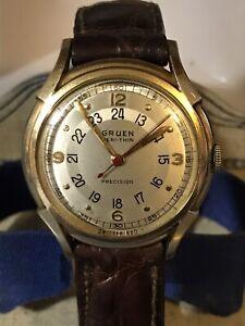 Gruen 420SS 17 Jewels Pan-American Mechanical Watch In A 14k Yellow Gold Case