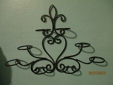 wrought iron wall candle holder holds 8 glass votive cups for tealights or small