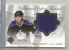 2008-09 Ultimate Collection Hockey Drew Doughty Debut Threads Card # 31/200 CSC