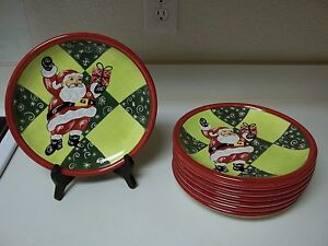 Claire Ware Santa Clause Stoneware 8 Plates 9 1/4 Inch Santa With Presents