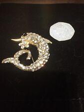 A Stunning Retro Gold Tone Dolphin & Flower Brooch