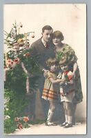 Paper Lantern Christmas Ornaments & Family RPPC Hand-Colored Tree Photo 1910s