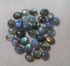 A PAIR OF 12x10mm OVAL CABOCHON-CUT NATURAL AFRICAN LABRADORITE GEMSTONES