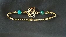 Gold tone and green Celtic Triquetra heart bracelet