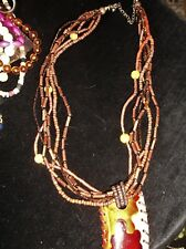 UNUSUAL 6 STRAND MICRO BROWN BEAD NECKLACE WITH DROP OBLONG ENAMELLED PENDANT