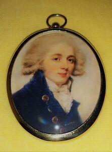 Portrait Miniature of Georgian gentleman wearing  blue jacket in  brass bezel.