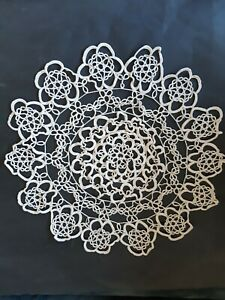 Vintage beige round shaped crocheted cloth/doily.