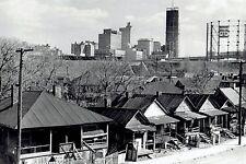 1966 Wire Photo Atlanta Georgia skyline is the backdrop of shacks in the ghetto