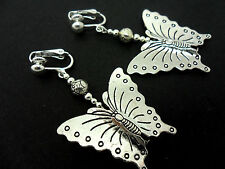 A PAIR OF BIG DANGLY BUTTERFLY CLIP ON  EARRINGS. NEW.