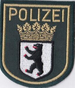 Polizei  Berlin  --  grün  --  gewebt  --