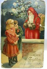 1905 POSTCARD MERRY CHRISTMAS, SANTA CLAUS IN RED HOODED ROBE WITH TREE,CHILDREN