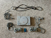 Sony Playstation 1 with (2) Clear Controllers and Cables + Memory Card (WORKS)