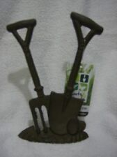 Door stopper in cast iron fork and spade