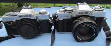 Pair Minolta 35mm SLR film cameras XG-M with 50mm lens & XG1 body