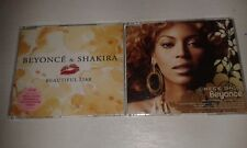 2 cds singles beyonce check on it  & beyonce and shakira beautiful liar