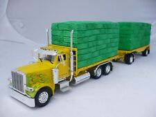 Peterbilt 388 day cab (yellow/Green flames) with truck & trailer flat with Hay