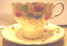 PARAGON TEA CUP AND SAUCER - PALE YELLOW WITH FLOWERS