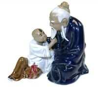 OLD MAN AND LITTLE BOY PULLING BEARD - Wanjiang China Mudman Blue Pottery