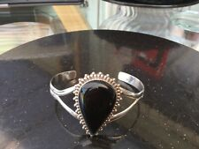 Black onyx and silver bangle - adjustable size. marked 925 silver