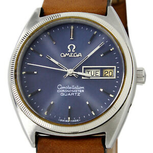 Omega Constellation Chronometer Quartz Day Date Sunburst Blue White Gold Bezel W