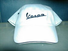 Vespa logo baseball style cap in white with navy text