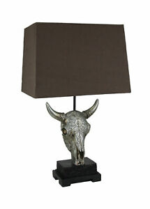Ornately Carved Cow Skull Table Lamp with Brown Fabric Shade