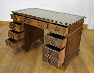 Antique style leather top pedestal writing desk