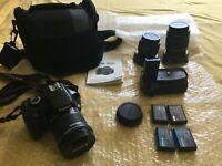 Fotocamera Canon EOS 1100D + 3 obbiettivi + battery grip + 4 batterie e sd 32gb