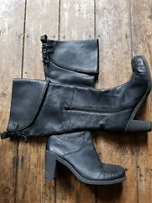 """Black leather Clarks boots size 5.5. With a 3"""" heel, Stitch detail, half zip."""