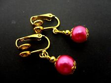 A PAIR OF SHORT GOLD COLOUR AND PINK  GLASS   PEARL  CLIP ON EARRINGS. NEW. 8MM.