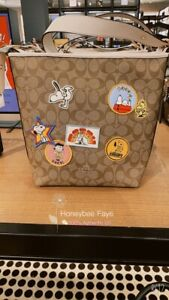 NWT Coach X Peanuts Val Duffle In Signature Canvas With Varsity Patches