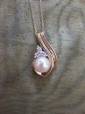 14ct Gold 0.03 Carat Diamond & Cultured Saltwater Pearl pendant. NEW