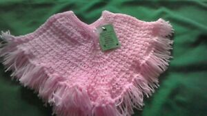 Hand-knitted  child's pink  poncho  age 2 years