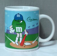 coffee mug tea cup, green baseball girl, yellow basketball, sports M&M's candy