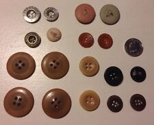 A COLLECTION OF VINTAGE BUTTONS WITH MAKERS NAMES ALL LISTED.