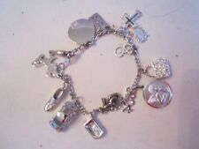 STERLING SILVER CHARM BRACELET WITH 15 CHARMS - 30 GRAMS - TUB SC2
