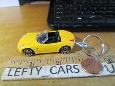 Maisto 2006 Pontiac Solstice Convertible Yellow Car Key chain Ring Scale 1/64