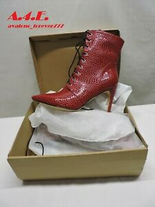 Sexy red snakeskin ankle boots.  Lace up and and zip in size 12